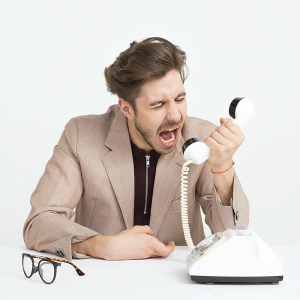 Image of man shouting down phone - image provided by Icons8 Team
